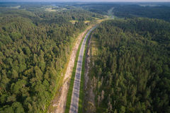 Aerial view of car driving on a road in the woods Royalty Free Stock Images