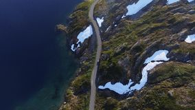 Aerial view of car on mountain road by the lake in Norway stock video
