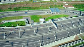 Car moving on highway in modern city with developed transport infrastructure. Aerial view car moving on highway road in modern city with developed transport stock footage
