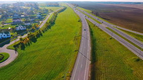 City road aerial view. Cars traffic on highway road. Aerial view car route. Aerial view car route in small town. Beautiful scenery country road and cars. Cars stock footage