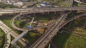 Aerial view of car traffic on highway. Aerial view of car traffic on road junction stock footage