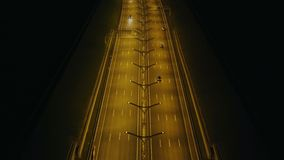 Aerial view car traffic in highway tunnel with night lighting in modern city. Aerial view car traffic in highway tunnel with night lighting on background modern stock video footage