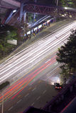 Aerial view of car traffic in night with bus station Royalty Free Stock Photo