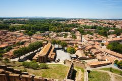 Carcassonne cityscape with Saint Gimer church. Aerial view of Carcassonne fortified city with Saint Gimer church, France, Europe stock photo