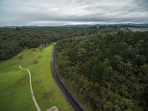 Aerial view of Cardinia Reservoir Park, Melbourne, Australia. Aerial view of Cardinia Reservoir Park - grassy area, walking path, winding road, and forest Royalty Free Stock Photos