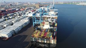 Aerial View of Cargo Container Ship Being Loaded Unloaded stock footage