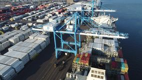 Aerial View of Cargo Container Ship Being Loaded Unloaded stock video footage