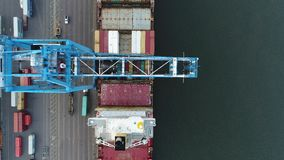 Aerial View of Cargo Container Ship Being Loaded Unloaded stock video