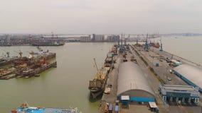 Cargo and passenger seaport in surabaya, java, indonesia. Aerial view cargo and passenger seaport with ships and crane Tanjung Perak, surabaya, indonesia. docks royalty free stock photos