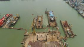 Cargo and passenger seaport in surabaya, java, indonesia. Aerial view cargo and passenger seaport with ships and crane Tanjung Perak, surabaya, indonesia. docks royalty free stock image
