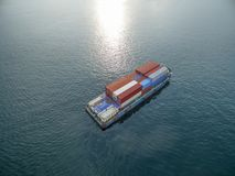 Aerial view of cargo ship, cargo container in warehouse harbor a Stock Image