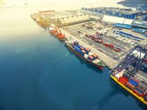 Aerial view of cargo ship, cargo container in warehouse harbor a Royalty Free Stock Photo