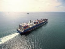 Aerial view of cargo ship, cargo container in warehouse harbor a. T thai Royalty Free Stock Image