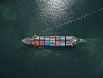 Aerial view of cargo ship, cargo container in warehouse harbor a. T thailand Royalty Free Stock Photos