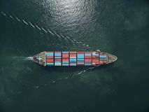 Aerial view of cargo ship, cargo container in warehouse harbor a Stock Photography
