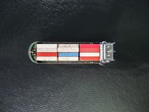 Aerial view of cargo ship, cargo container in warehouse harbor a Royalty Free Stock Images