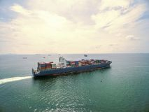 Aerial view of cargo ship, cargo container in warehouse harbor a. T thai Stock Photos