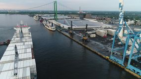 Aerial View of Cargo Ship Entering Port of Philadelphia and Parking.  stock video footage