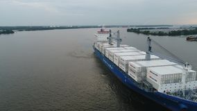Aerial View of Cargo Ship Entering Port of Philadelphia and Parking stock footage