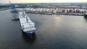 Aerial View of Cargo Ship Entering Port of Philadelphia and Parking stock video footage