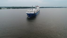 Aerial View of Cargo Ship Entering Port of Philadelphia and Parking.  stock footage