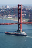 Aerial View of Cargo ship passing under Golden Gate Bridge Stock Photography