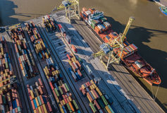 Top view of container ship unloading in port stock images