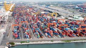Aerial view of cargo ships loading containers at seaport Stock Image