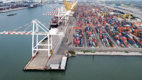 Aerial view of cargo ships loading containers at seaport Royalty Free Stock Photography
