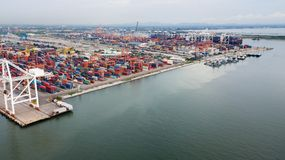 Aerial view of cargo ships loading containers at seaport Stock Images