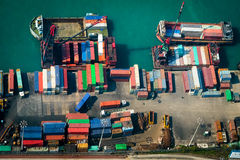 Aerial view of cargo ships at port terminal. Hong Kong Stock Photos