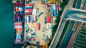 Aerial view of cargo ships at port terminal. Hong Kong Stock Photo