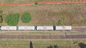 Aerial view on a cargo tanks train. Aerial view from drone on a stationary cargo tanks train stock footage