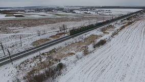 Aerial view of cargo train delivering goods, fuel, petrolium in winter. 4K stock video