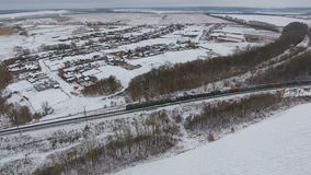 Aerial view of cargo train delivering goods, fuel, petrolium in winter. stock video
