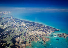 Aerial view of Caribbean Bahamas islands rising in a turquoise sea. Aerial view of Caribbean Bahamas islands spreading below in a turquoise sea stock photo