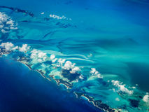 Aerial view of Caribbean islands chain creating a blue desert contour. Aerial view of Caribbean islands chain surrounded by turquoise water creating a blue stock image