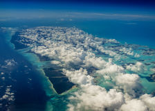 Aerial view of Caribbean islands dotted by bright white clouds Stock Photography