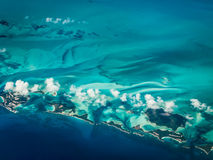 Aerial view of Caribbean islands surrounded by greenish turquoise of water near barrier reefs. Aerial view of chain of Caribbean islands surrounded by greenish stock photography