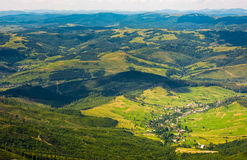 Aerial view of carpathian countryside. Beautiful summer weather in mountains Royalty Free Stock Images