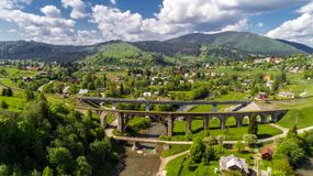 Aerial view of Carpathian mountains in summer. Village in the mountains. stock photos