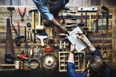 Aerial view of carpenter man listing checking tools equipment. Aerial view of carpenter men listing checking tools equipment Royalty Free Stock Photography