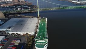 Aerial View Carrier Ship Unloading Cars Delaware River stock footage