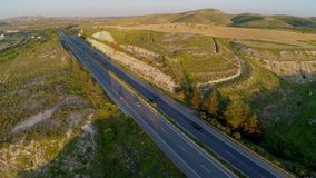 Aerial view of cars driving actively on modern highway filmed with quadrocopter stock video footage