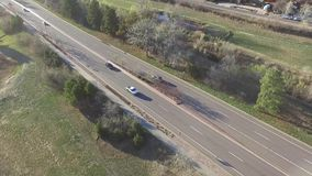 Aerial view of cars driving on road stock video
