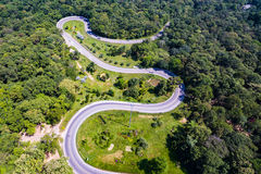 Aerial view of cars are going through a curve road Stock Photography