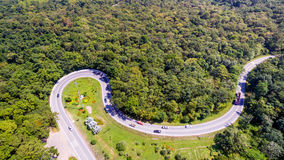 Aerial view of cars are going through a curve road Royalty Free Stock Photography