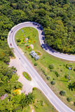 Aerial view of cars are going through a curve road Stock Images
