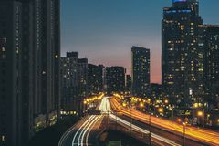 Aerial View of Cars and Lighted City Building during Night in Time Lapse Stock Photo