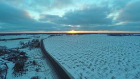 Aerial view of cars moving on winter road. Amazing sunset. Nature winter landscape. Aerial footage stock video footage